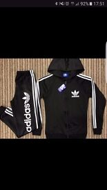 Addias tracksuit womens small