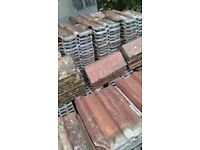 310 clay double roman tiles,only the best kept, plus 24 ridges. £450 can deliver locally.