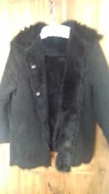 Woman' jacket. Fur lined size 14 charcoal black