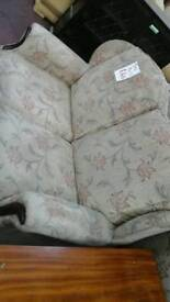 It's a light brown flower pattern 2 seater sofa with 2 matching chairs