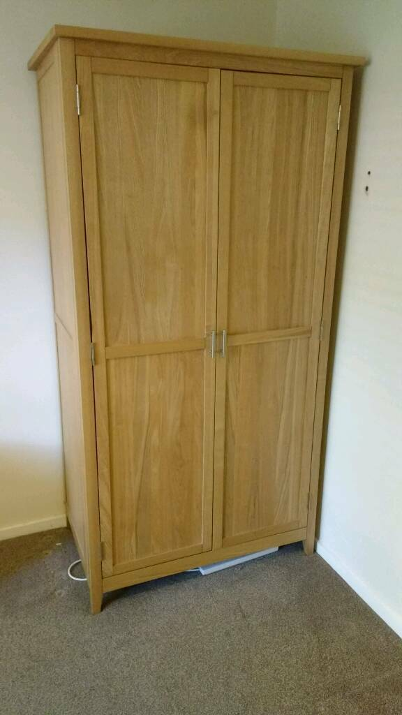 "Light oak solid wardrobein Cheadle Hulme, Manchester - Light oak wardrobe in excellent condition minimal marks. Will need to be disassembled to transport easy 2 mins job. Cost over £200 new. Call for delivery quote or any other information w40"" h76"". D25"""