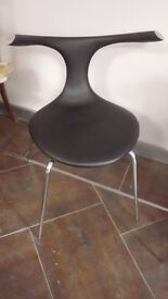 four black and chrome dining chairs