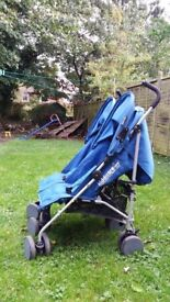 Twin'Kiddicare' foldable buggy with sunshades & raincover