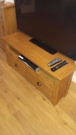 Solid wood television stand.