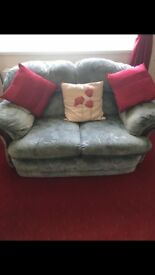 3 piece suite which is two seater sofa and arm chairs