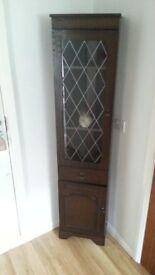 Dark wood corner cupboard 1.8m tall . Lead framed glass. Wooden shelves