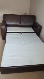 Very good condition 2 seater sofa bed brown leather