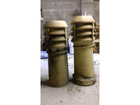 Original reclaimed chimney pots, buff in colour and louvered.