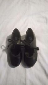 Leotard and tap shoes