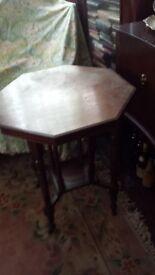 SOLID OAK OCTAGONAL TEA TABLE ON CASTERS (ORIGINAL) BETTER LOOKING THAN PICS.