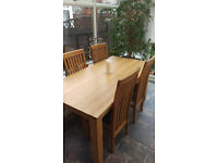 Large solid oak dining table with 6 oak chairs