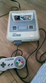 SUPER NINTENDO (SNES) WITH ALL WIRES 1 CONTROLLER AND STREET FIGHTER II GAME