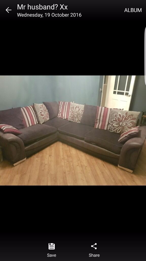 Corner sofa in black, grey and purple. Three years old in good condition
