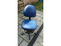 Blue desk chair with adjustable height / tilt and foot rest