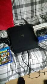 Playstation PRO 1TB console with extra remote and crash bandicoot