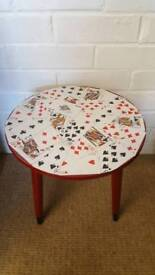 Small red table with playing card top