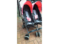 Obaby Apollo Twin umbrella fold stroller in good condition. Pink and black.