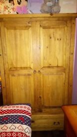 Solid wood wardrobe with drawer at bottom
