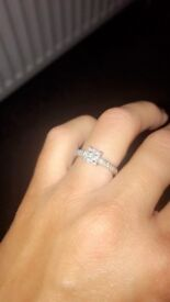 Princess cut .60 carat diamond cluster ring with diamond set shoulders in 9 carat white gold