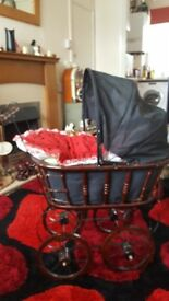 Vanity dolls pram with wooden frame and wheels