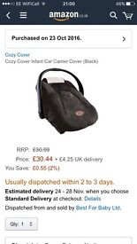 Cozy cover for car seat - bought brand new and never used. Universal size fits any baby car seat