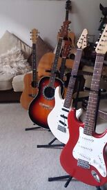 Encore Electric. Strat copy vgc for a used guitar, its all there. Ideal starter elec model In Red