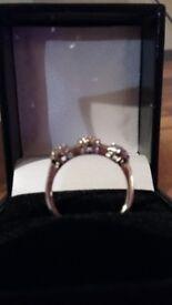 Diamond triple cluster half eternity ring