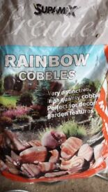 Unopened bag Rainbow cobbles for garden or pond