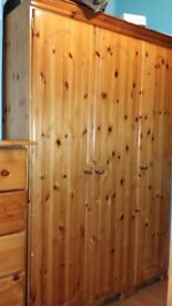 3 door pure pine wardrobe in an excellant condition. just 1yr old. quick sale price, £80