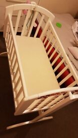 White baby crib with mattress