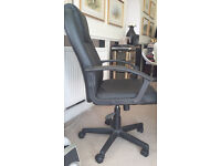 GREAT CONDITION Black office chair on wheels. Swivels, adjustable height, full arm rests.