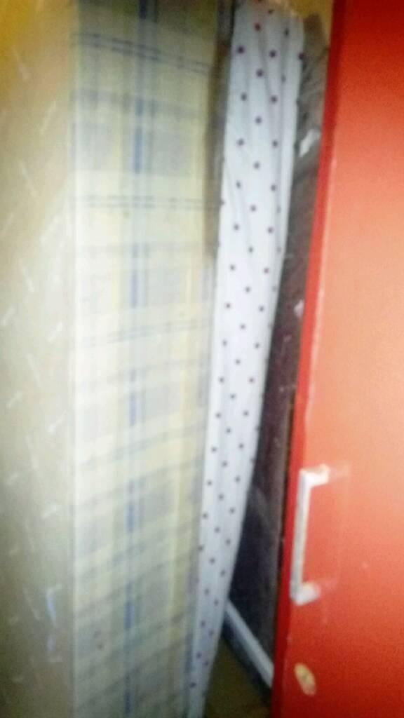 Single bed with single mattress and single wardrobe