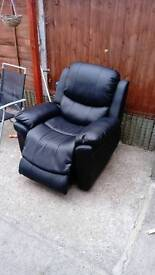 Black Leather Rise and Recline Armchair, Brand New Purchased a month agp