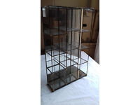 Nice small glass/metal display unit with mirrored back