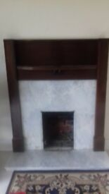 Wooden fire surround with marble backing. Good condition