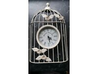 Beautiful clock in beds cage wall decoration in very good condition!can deliver or post!