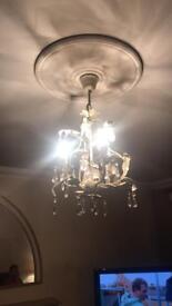 White glass tear drop chandelier light fitting.