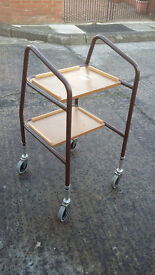 metal framed disabled walker with 2 trays at the front