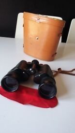 vintage binoculars in a leather case excellent condition