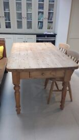 Solid pine kitchen table with drawer. Dimensions 90cm wide by 152cm length.