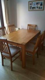 Solid oak table & 6 chairs in great condition.