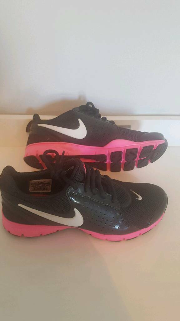 162a256991b Brand new ladies black and pink Nike trainers