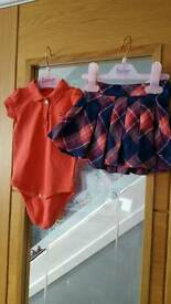 A selection of baby girl designer outfits
