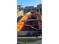 GRP clinker style boat with trailer and electric outboard motor.