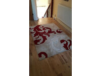Large cream and red rug.