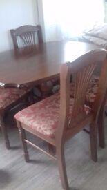 Table and four chairs mahoganny colour pedastool table.