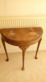 Semi circular brown table (antique).
