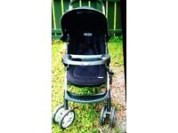 Graco buggy / pushchair / stroller with raincover.