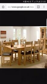 Oak table and brown chairs