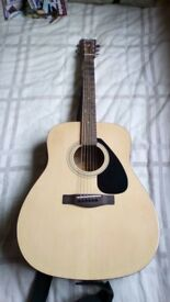 Yamaha F310 guitar for sale with accessorises
